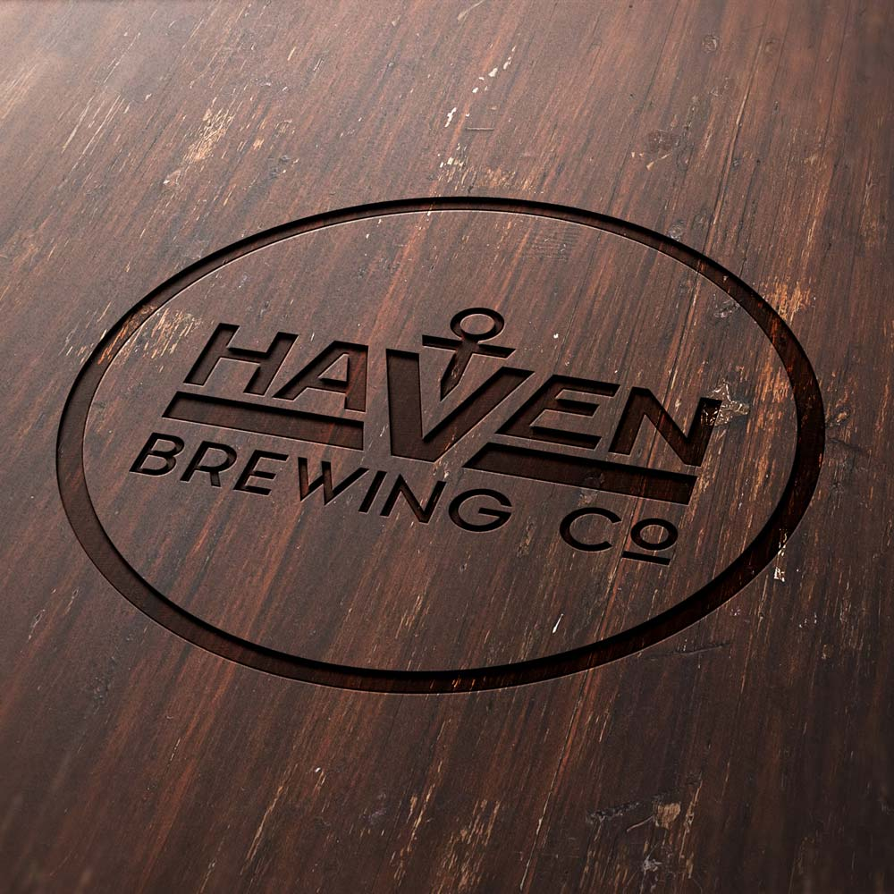 Haven Brewing Company logo engraved in wood.